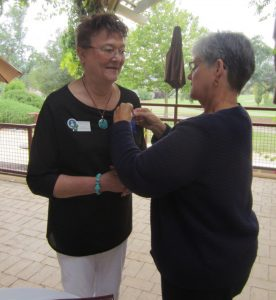 Karen Strand presents Billie Westernoff with her Past President's pin