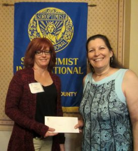 Kimberly C. Girard, left, being awarded SICC's Live Your Dream award for 2015 by SICC's LYD committee member, Susan Rudolph