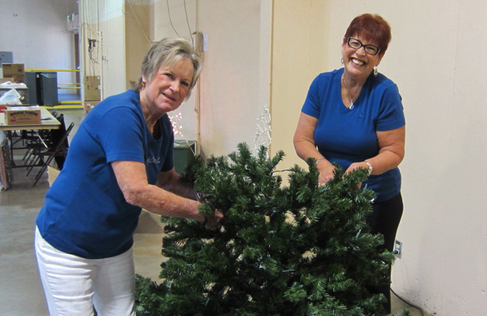 Roberta and Norma assemble a tree