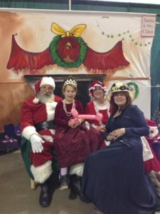 Santa, Mrs. Claus and mother and daughter at 2013's Tea